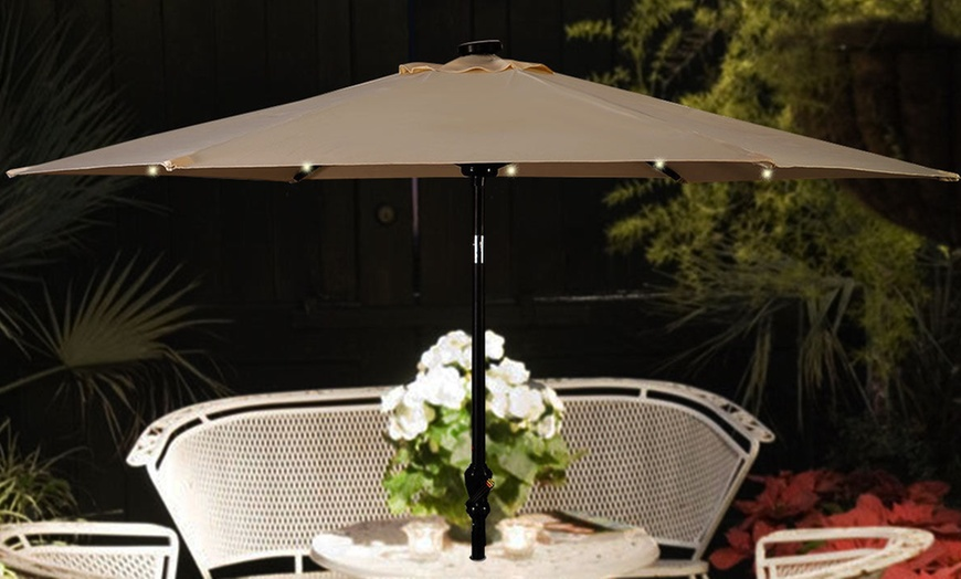 9 ft patio umbrella with solar powered led lights and hand crank