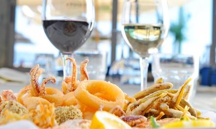 Menu di pesce con un litro di vino per 2 o 4 persone da Ristorante Pizzeria Castelluccio (sconto fino a 63%)