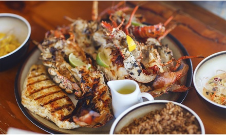 Menu pesce di 4 portate e bottiglia di vino per 2 o 4 persone al ristorante Mezzaluna (sconto fino a 56%)