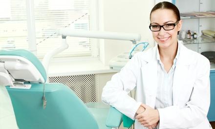 Visita specialistica e pulizia dei denti più otturazione e sbiancamento Led (sconto fino a 88%)