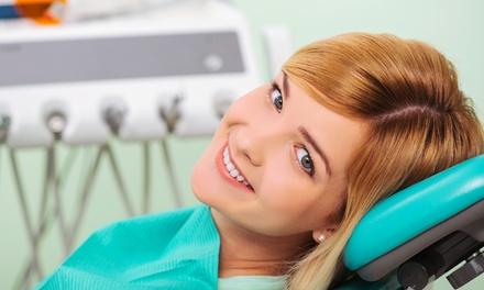 Visita con pulizia dei denti, smacchiamento airflow e ortopanoramica da Dental Care (sconto fino a 82%)