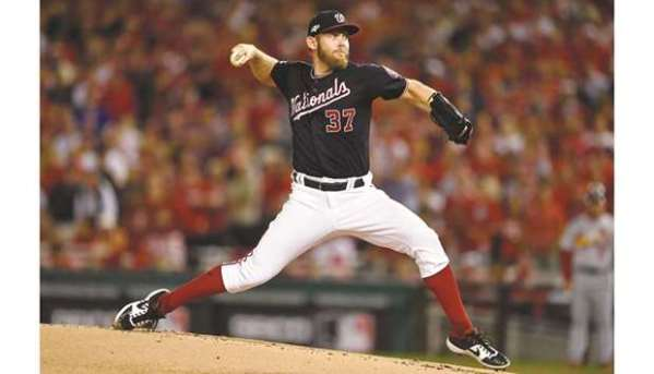Strasburg dominates as Nationals lead World Series 3-0