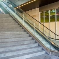Floor Mount Indoor U Channel Glass Balustrade Modern Stair Balcony | Modern Staircase Glass Railing Designs | Commercial Building | Glass Panel Wooden Handrail | Side Glass Rail | Glass Stair | Modern Aluminium