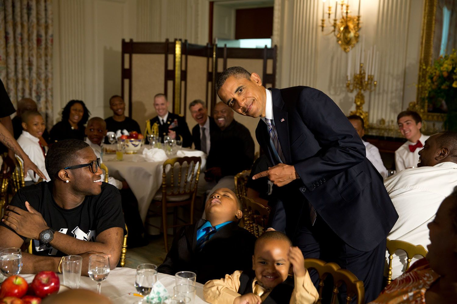 "June 14, 2013 ""The President called me over to pose for a photo with a young boy who had fallen asleep during the Father's Day ice cream social in the State Dining Room of the White House."" (Official White House Photo by Pete Souza)"