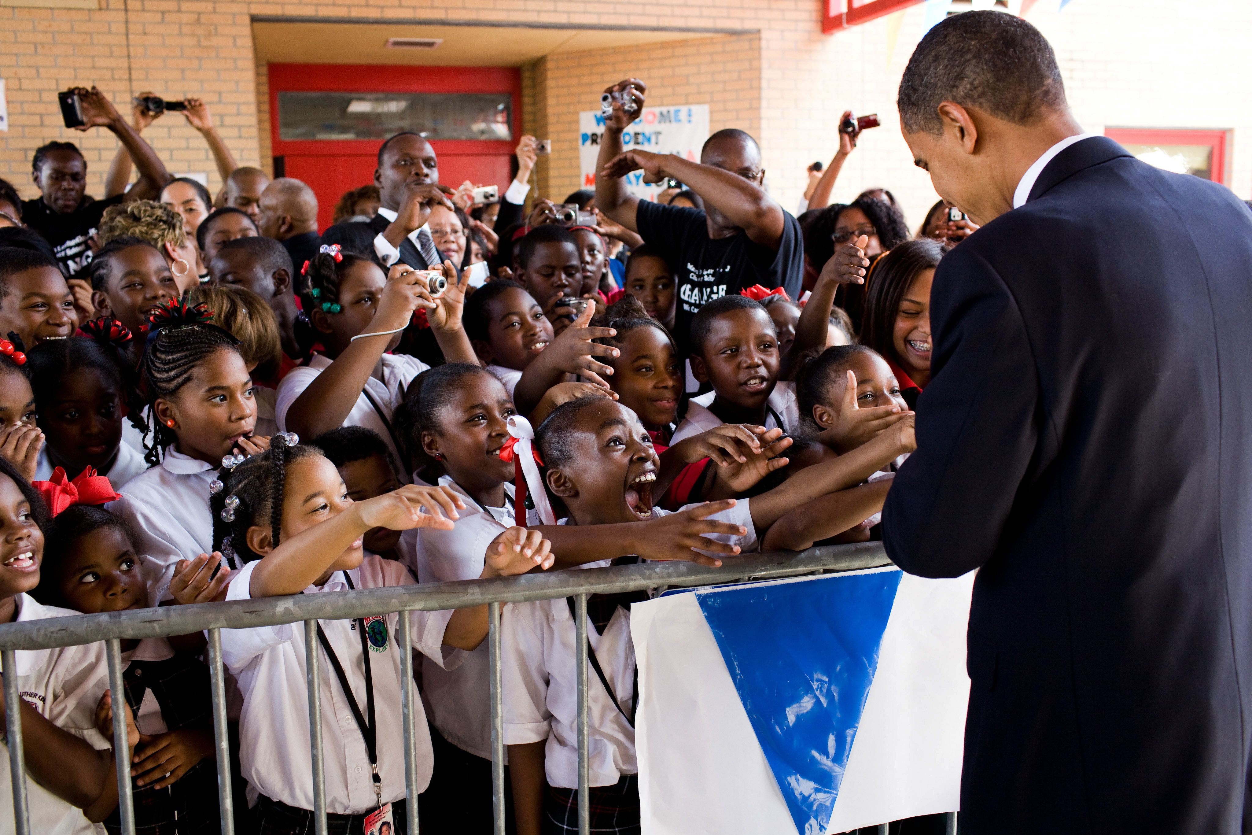 Students show their excitement at meeting President Barack Obama during his visit to Dr. Martin Luther King Jr. Charter School in New Orleans, La., Oct. 15, 2009. (Official White House Photo by Pete Souza)
