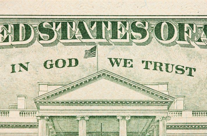 """The phrase""""In God We Trust,"""" whichappearson the reverse side of a $20 bill, is being challenged by 41 plain"""