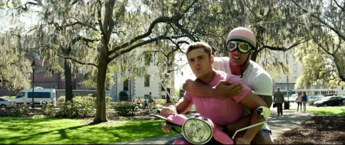 Watch The Rock And Zac Efron Try To Ride A Pink Scooter Together Watch The Rock And Zac Efron Try To Ride A Pink Scooter Together 5991f6f62200002d001a5e04