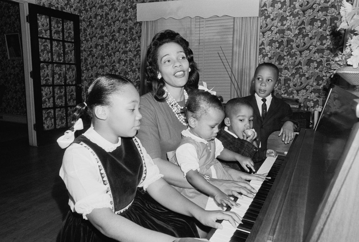 Coretta Scott King and her childrencelebrate the announcement that King was awarded the Nobel Peace Prize on Oct. 16, 1