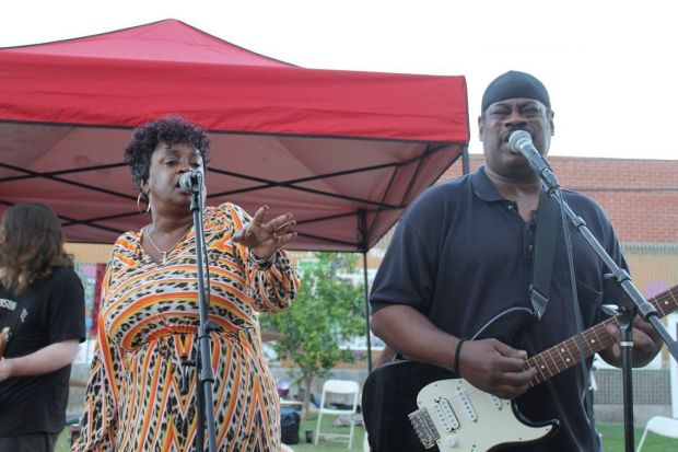 Franc's Melting Pot performs with singer Demetra Wilson-Washington, left, on the event stage at Gladys Park.