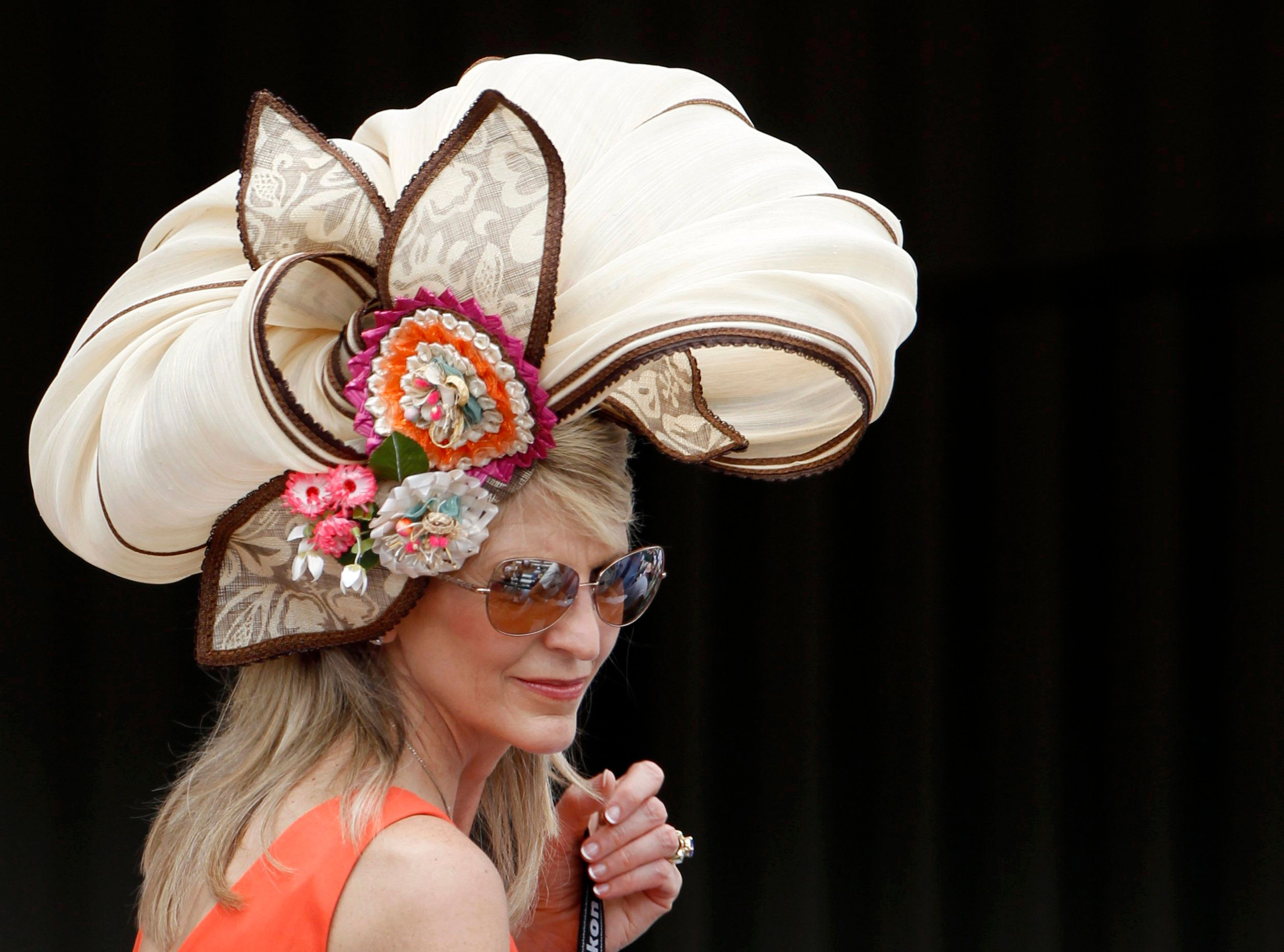 A woman wears a fancy hat at the derby on May 5, 2012.