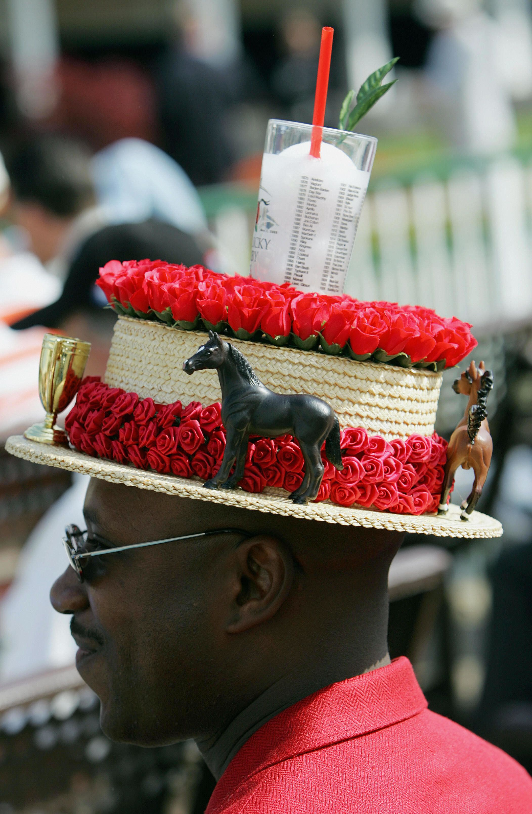 The classic mint julep glass sits atop a derby hat worn by a race fan in 2005.