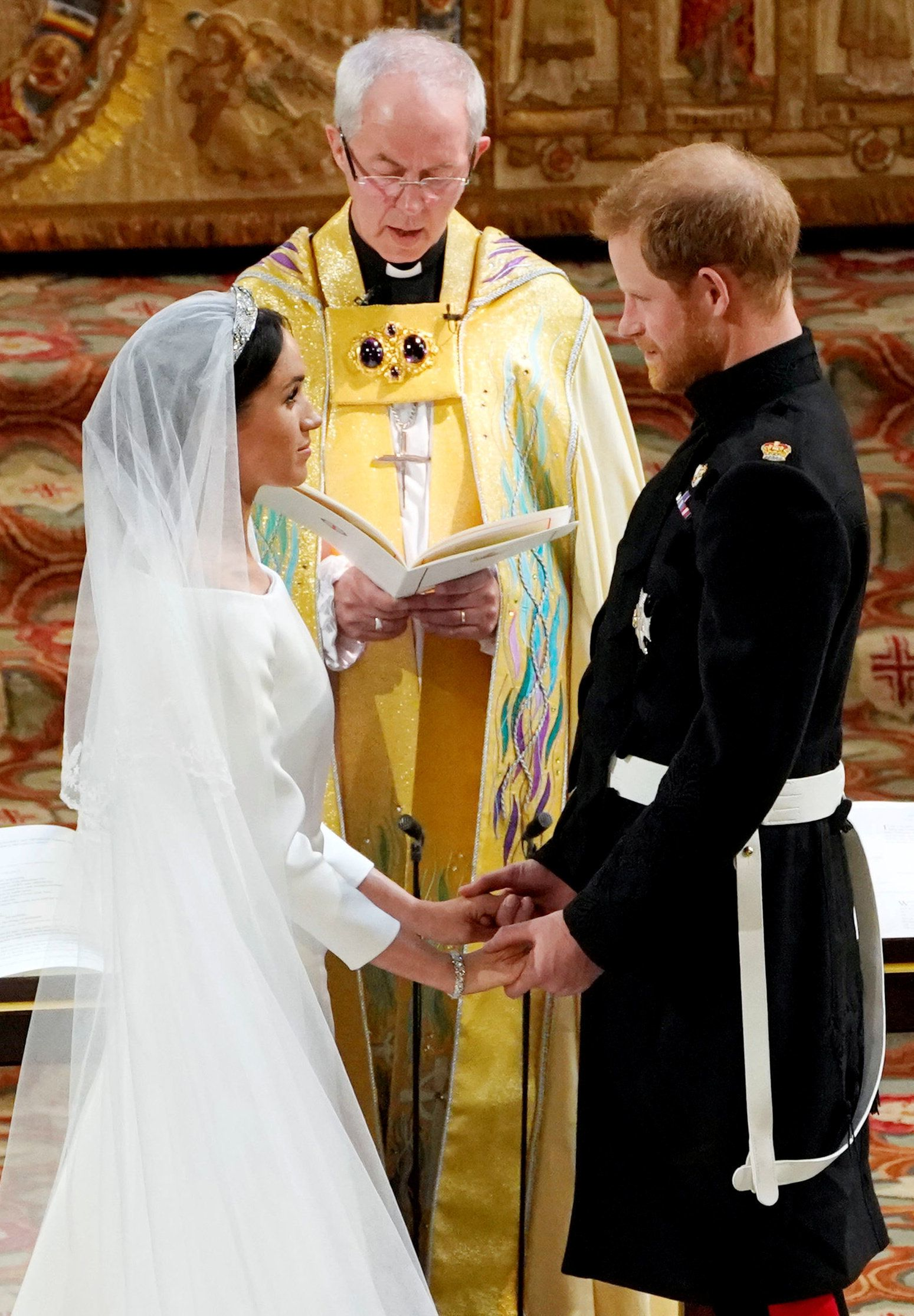 Prince Harry and Meghan Markle exchange vows in St George's Chapel at Windsor Castle during their wedding service, conducted