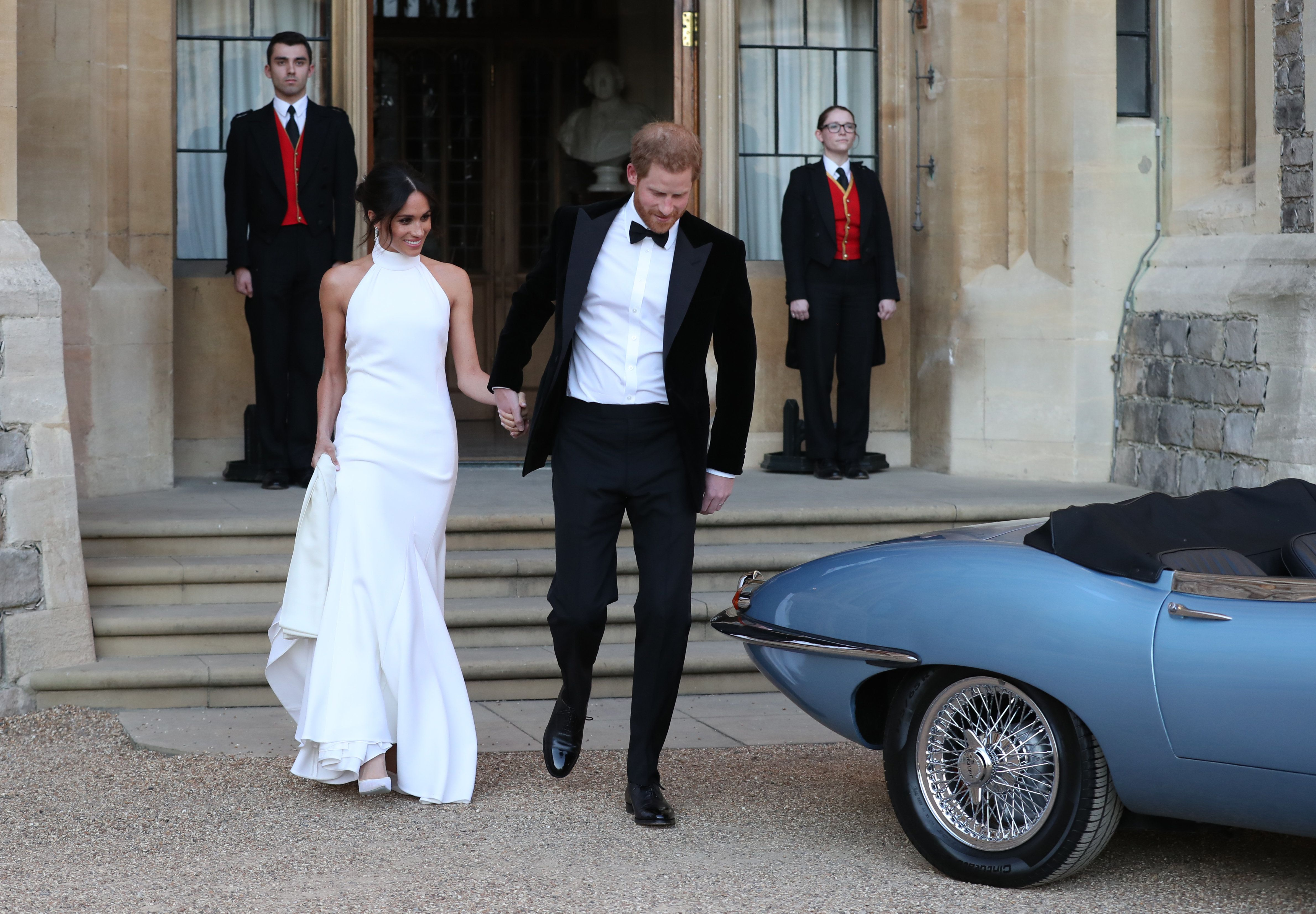 Duchess of Sussex and Prince Harry, Duke of Sussex leave Windsor Castle after their wedding to attend an evening reception at