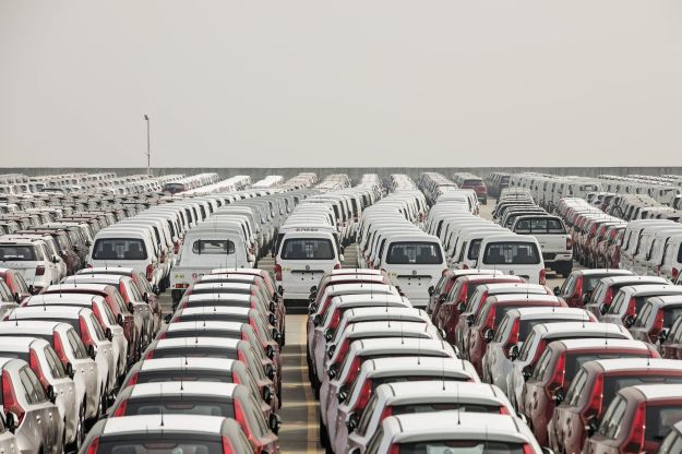 Vehicles stand at a port in Shanghaion April 30.
