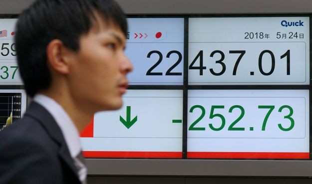 Shares in automakers were battered by the news, dragging down Tokyo's benchmark Nikkei index on May 24.