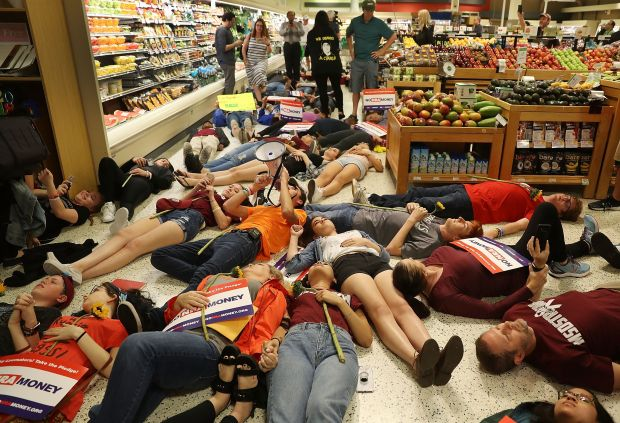 """Protestersstage a """"die in"""" protest at a Publix supermarket in Coral Springs, Florida, after the grocery store chain gav"""