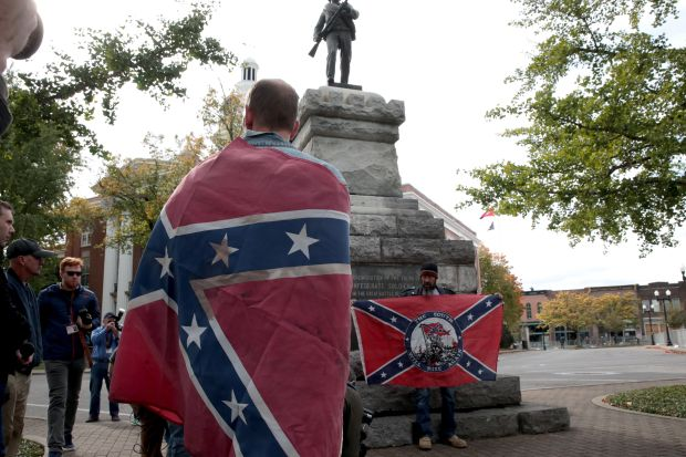"""Confederate flags are displayed at a """"White Lives Matter"""" rally on Oct. 28 in Murfreesboro, Tennessee."""