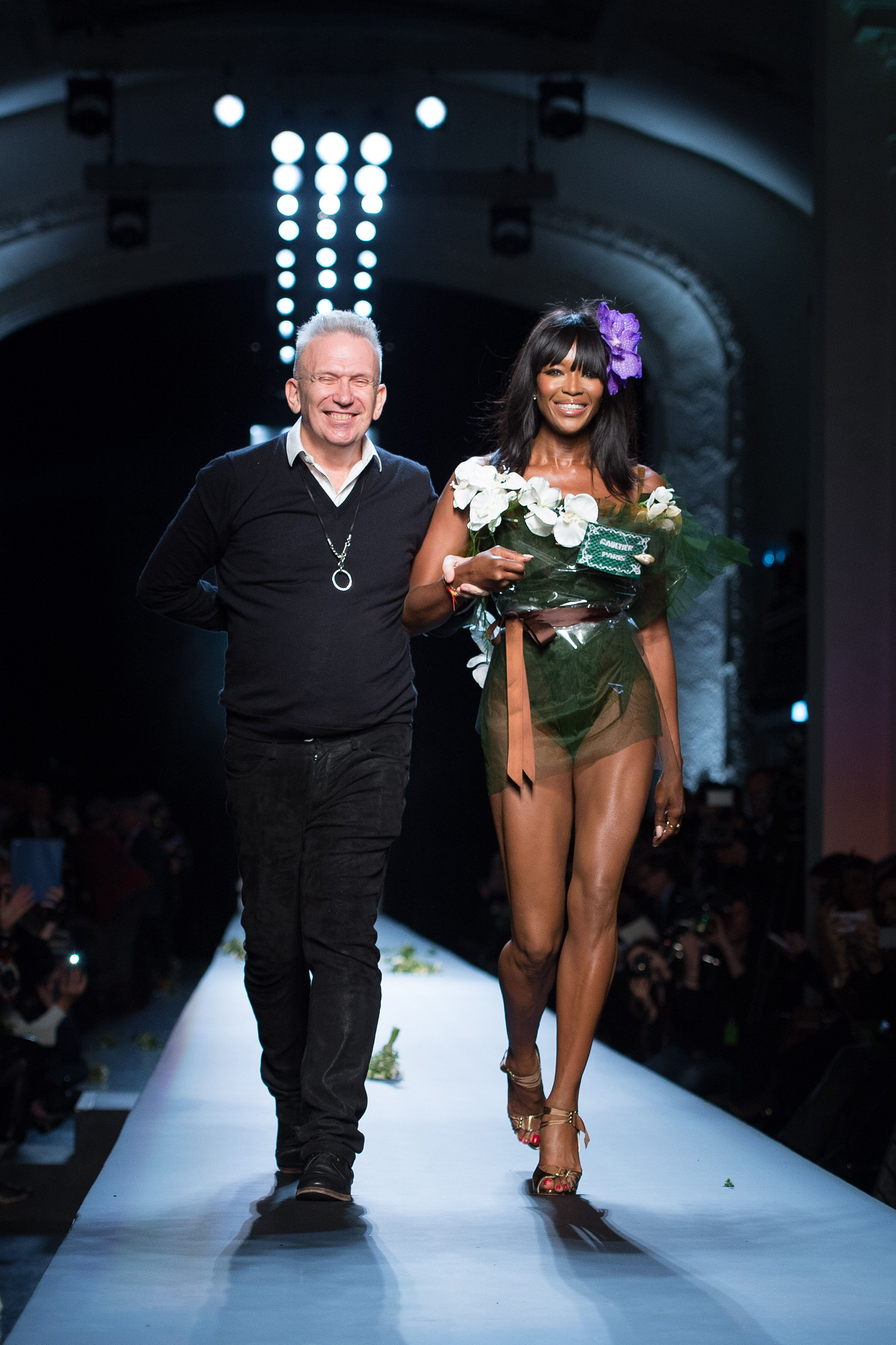 With fashion designer Jean Paul Gaultier at the end of his show as part of Paris Fashion Week.