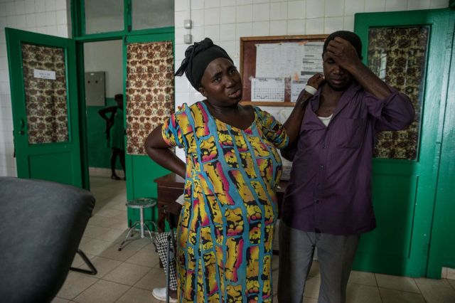 Aissatu Seidi leans against husband Mamudo Queta for support in the delivery room at a hospital in Canchungo, in th