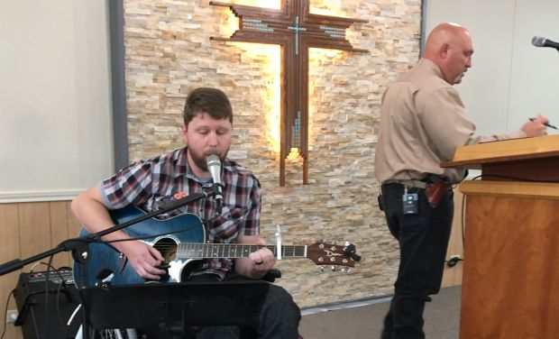 Kris Workman, 34, performs from his wheelchair at Sutherland Springs Baptist Church while the Rev. Frank Pomeroy, 52, wearing