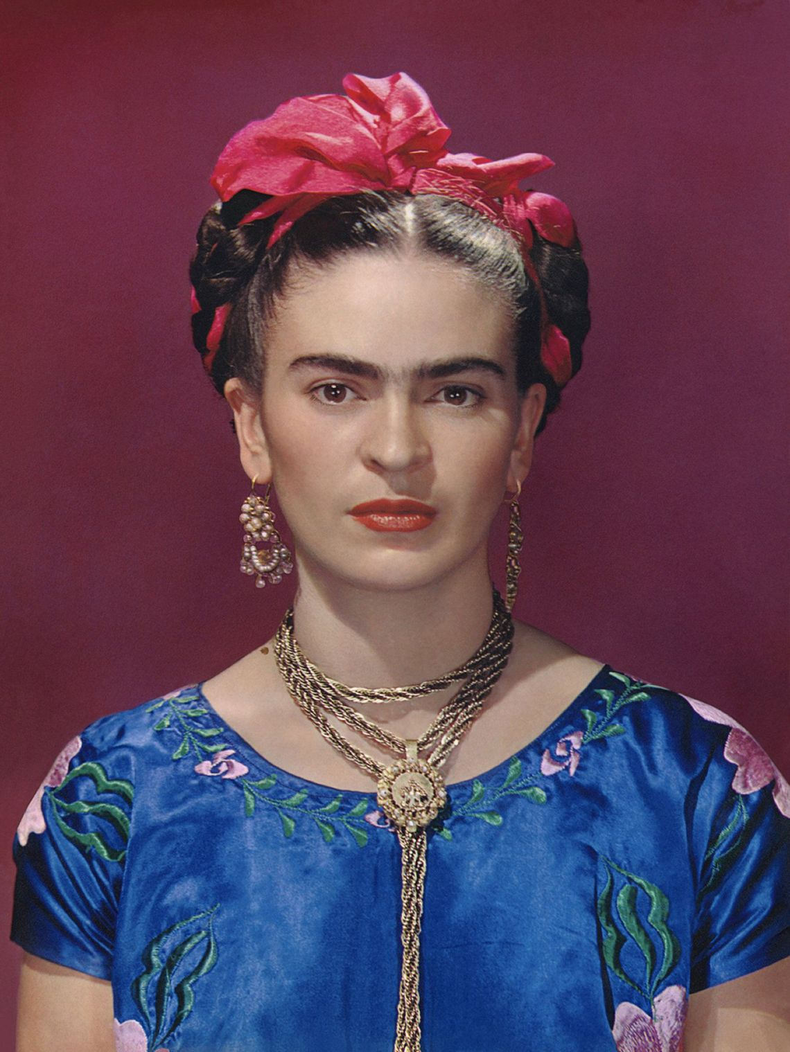 Frida Kahlo in blue satin blouse, 1939.