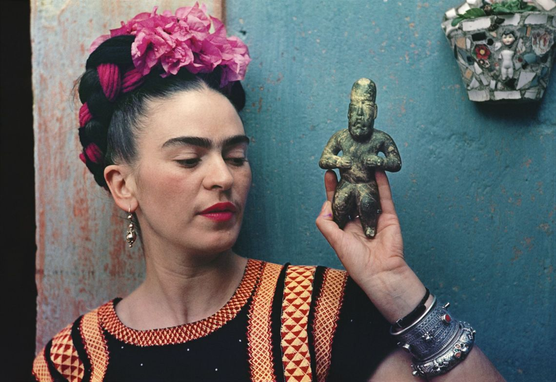 Frida Kahlo with Olmec figurine, 1939.