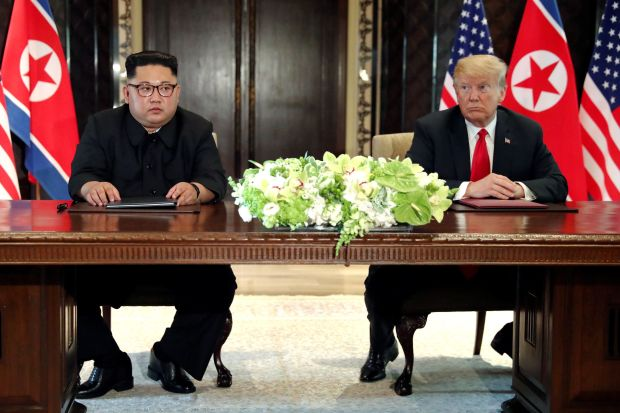 President Donald Trump and North Korean leader Kim Jong Un hold a signing ceremony at the conclusion of their summit in Singa