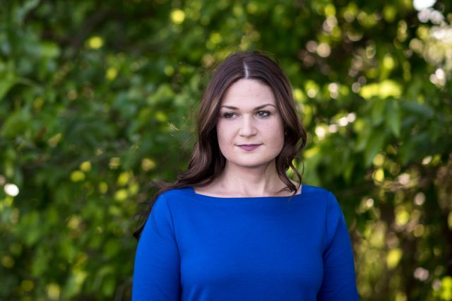 Abby Finkenauer stands for a portrait onfamily property in Dubuque, Iowa,on June 4.