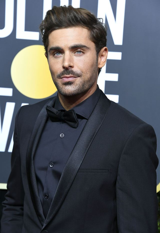 Zac Efron arrives at the 75th Annual Golden Globe Awards.