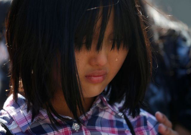 Ten-year-old Naomi Lien cries as she takes part in a statement to the media about immigration outside the Supreme Court on Ju