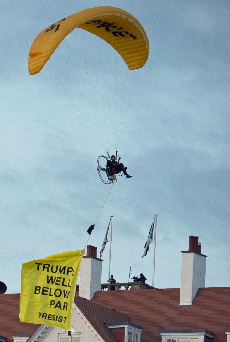 The Greenpeace protester flies a microlight