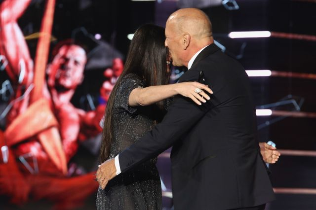 Moore andWillis hug it out after she ribbed him at his Comedy Central roast.