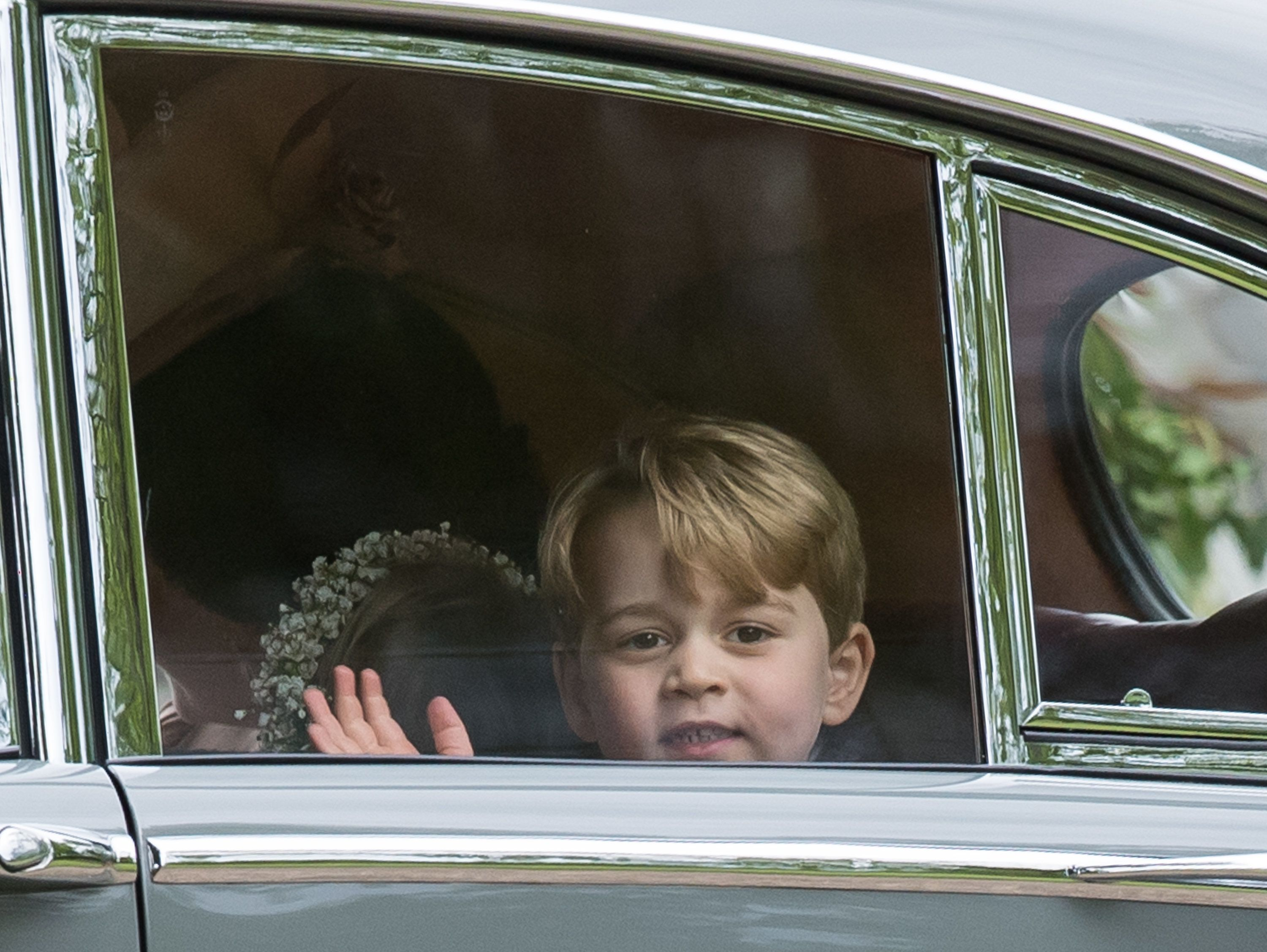 Pageboy Prince George waves as he leaves the wedding Of Pippa Middleton and James Matthews at St Mark's Church on May 20, 201