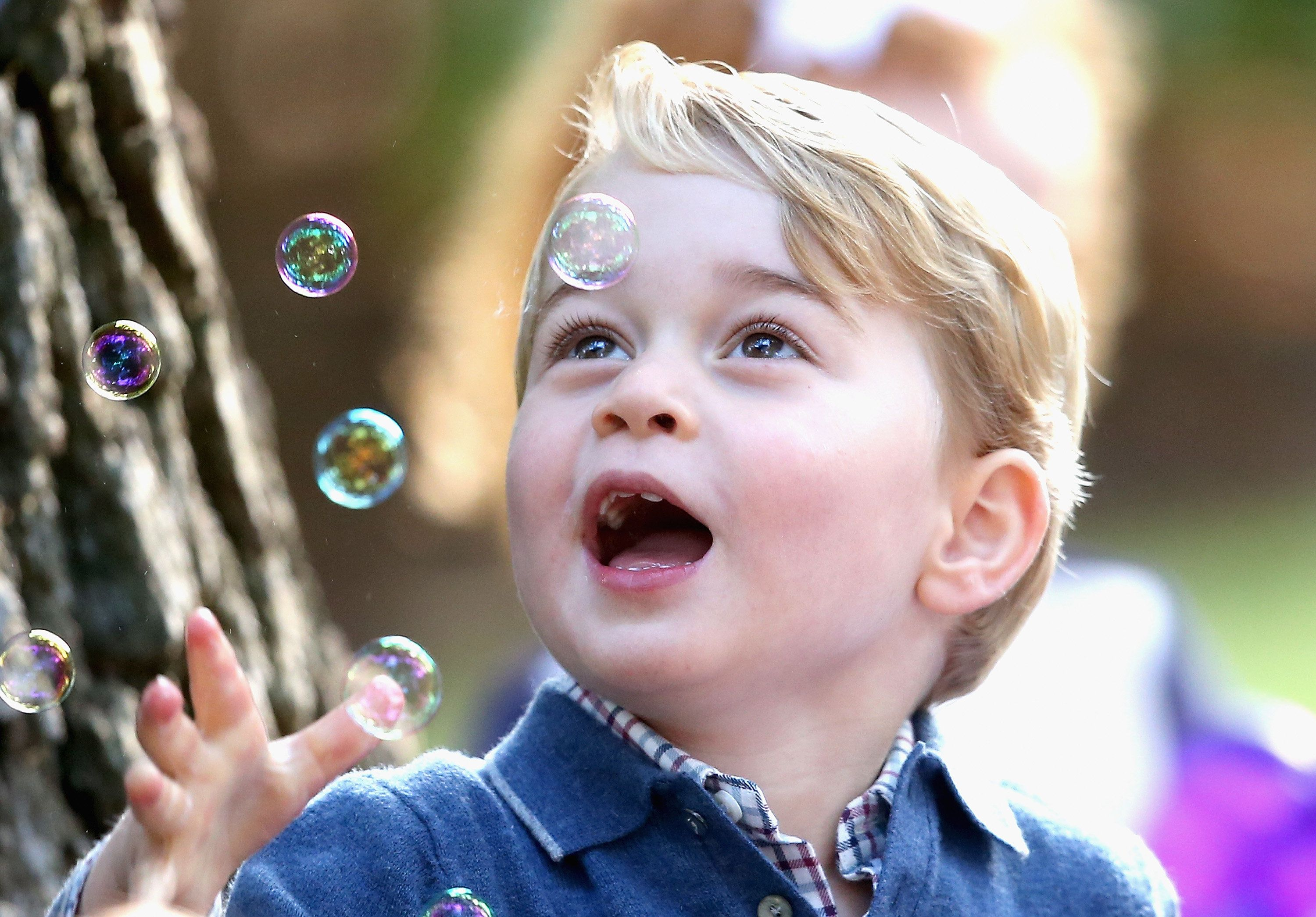 Prince George of Cambridge plays with bubbles at a children's party for military families during the Royal Tour of Canada on&