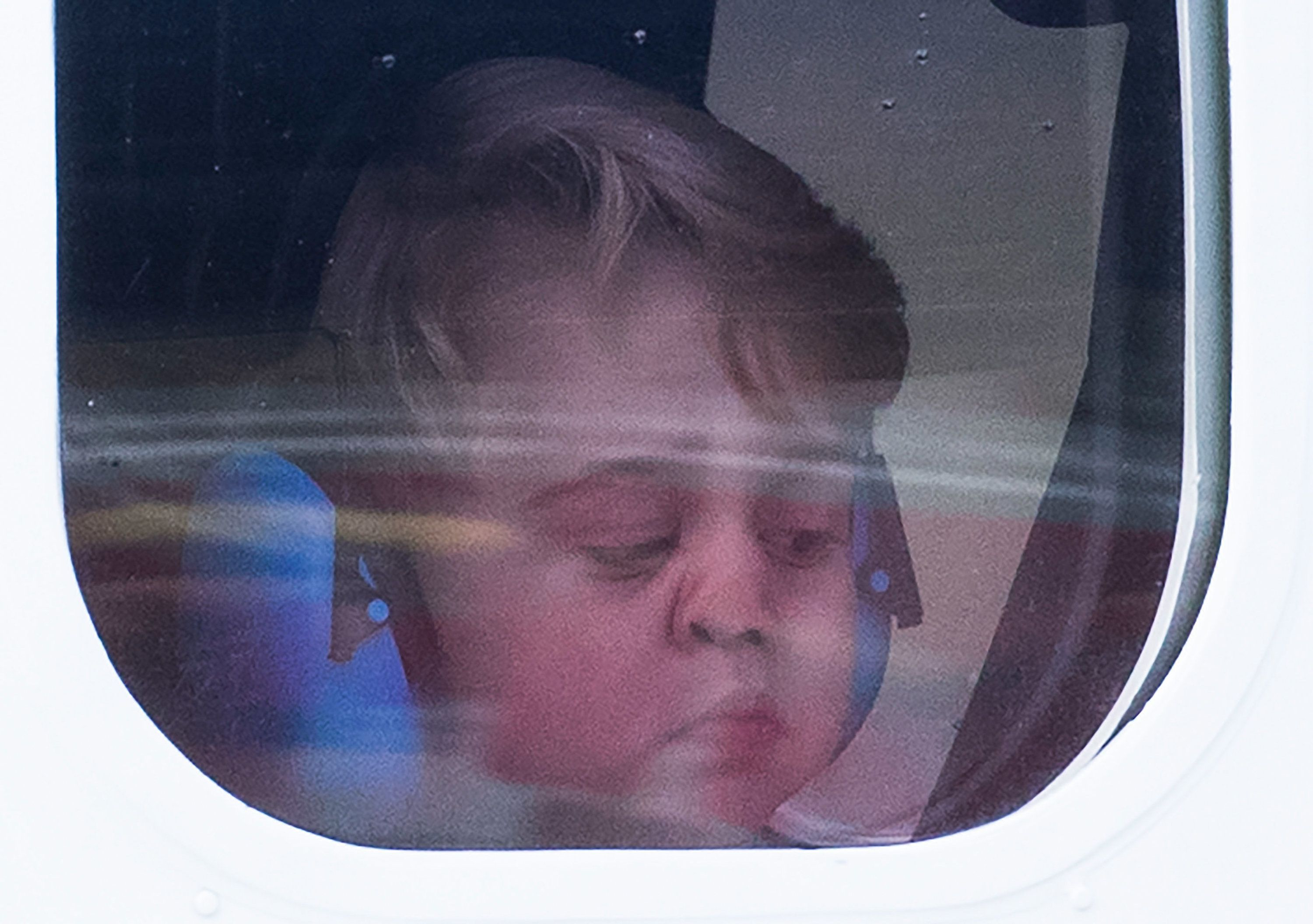 Prince George of Cambridge looks out of the window of a sea plane as he departs Victoria onOct. 1, 2016, in Victoria, C