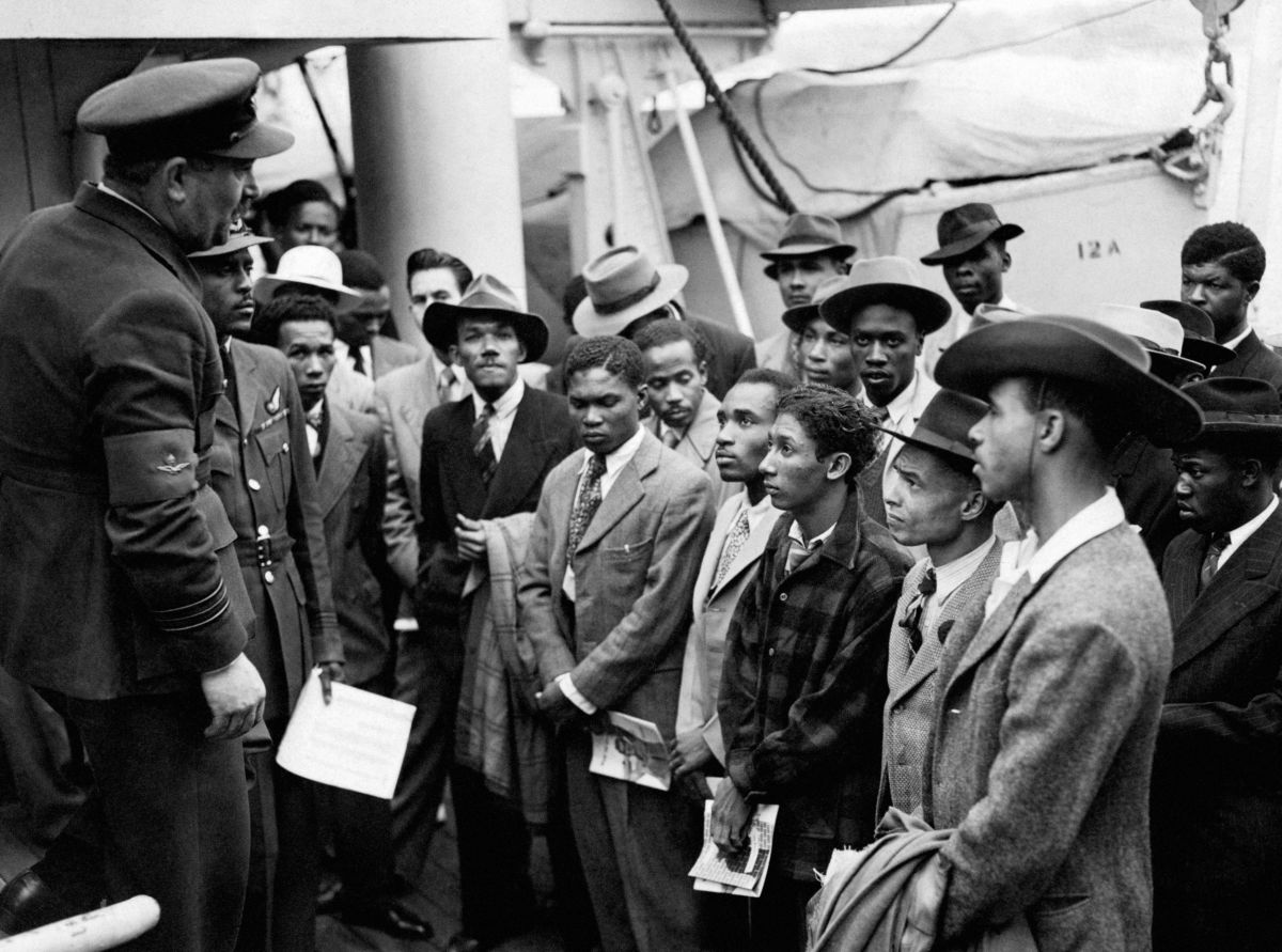 Jamaican immigrants welcomed by RAF officials from the Colonial Office after the ex-troopship HMT 'Empire...