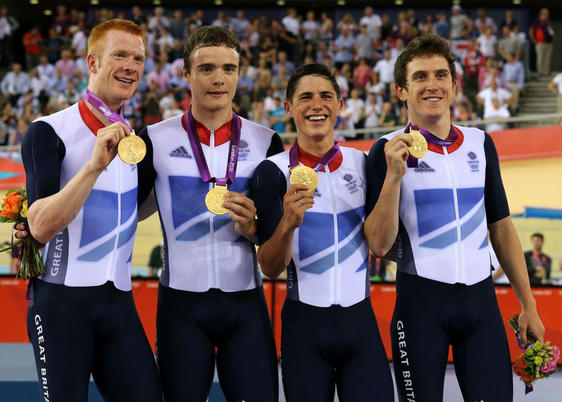 Thomas with Great Britain's Ed Clancy, Steven Burke and Peter Kennaugh celebrating with their gold medals in the men's team pursuit at the 2012 Olympic Games.