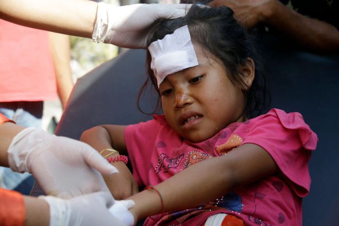 This unnamed girl was treated in Mataram Lombok, Indonesia on Thursday after she was injured in the quake.