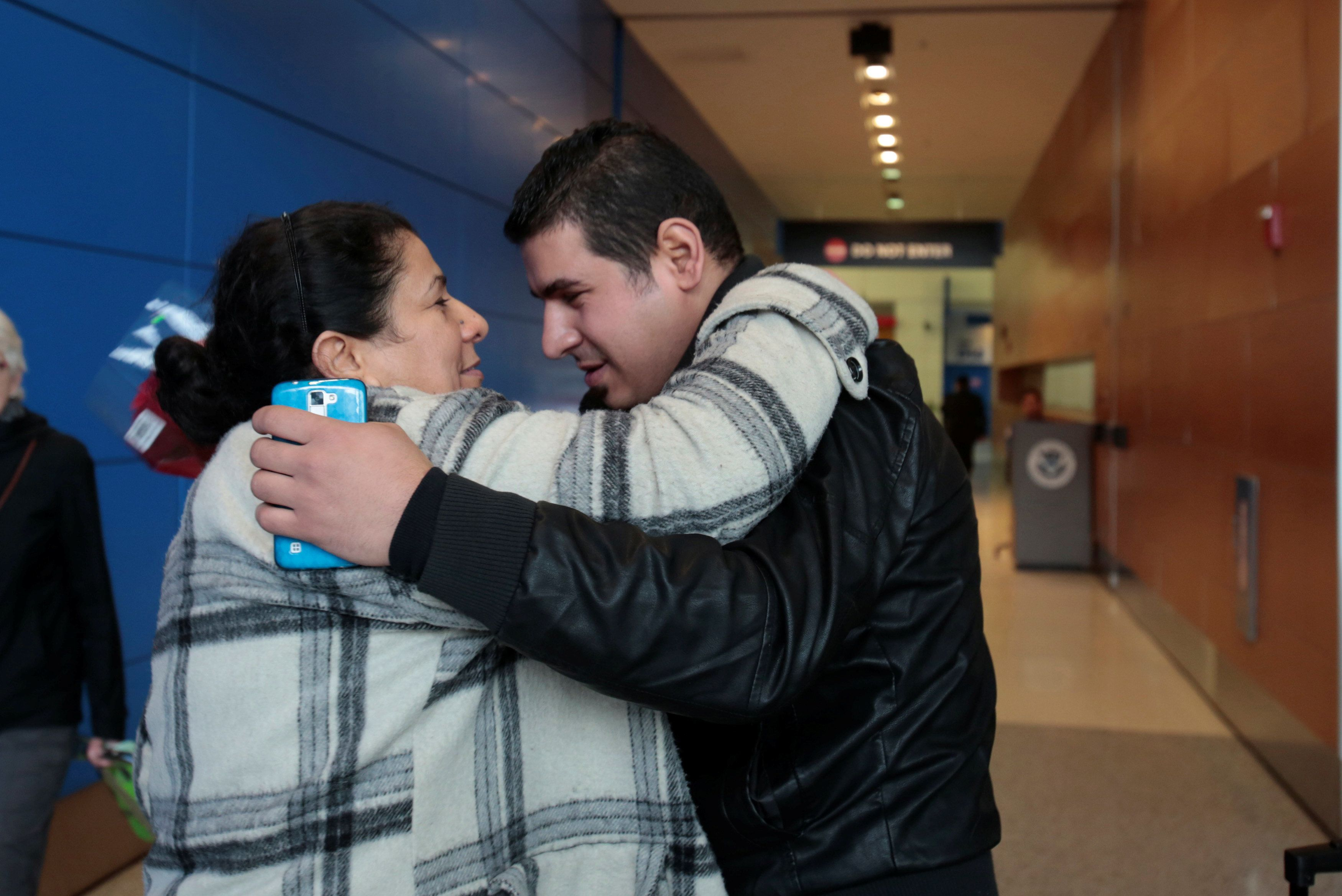 Iraqi refugee Amira Al-Qassab is reunited with her son Rami after arriving with her other children at Detroit Metro Airport i