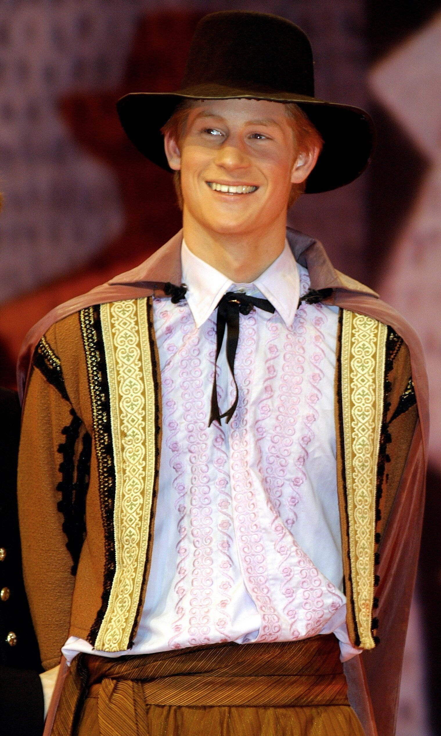 "Prince Harry acts in a masked ball scene in a production of ""Much Ado About Nothing"" at Eton College in March 2003."