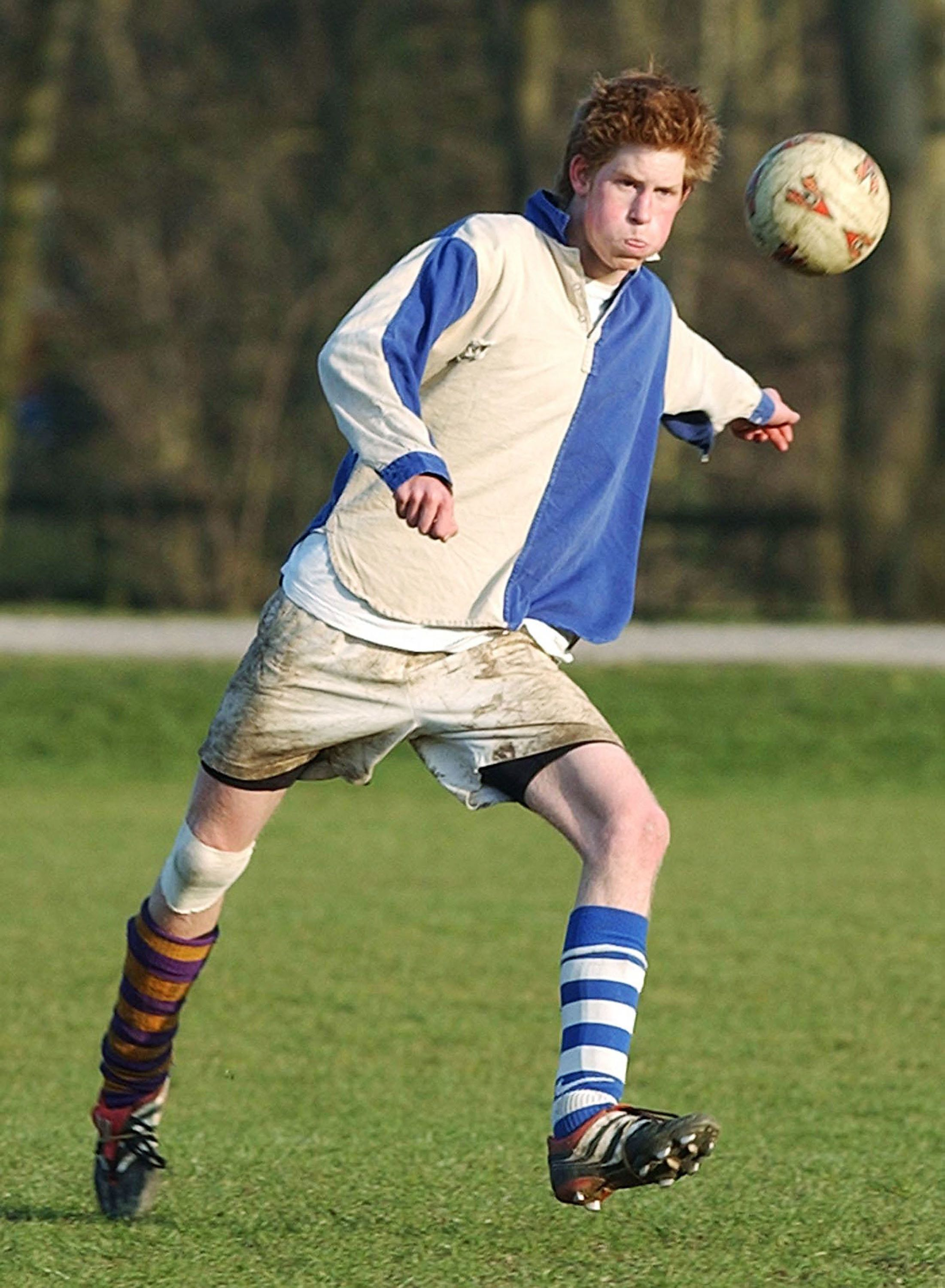 """Prince Harry takes part in the field game against a team of """"Old Boys"""" in March 2003 at Eton."""