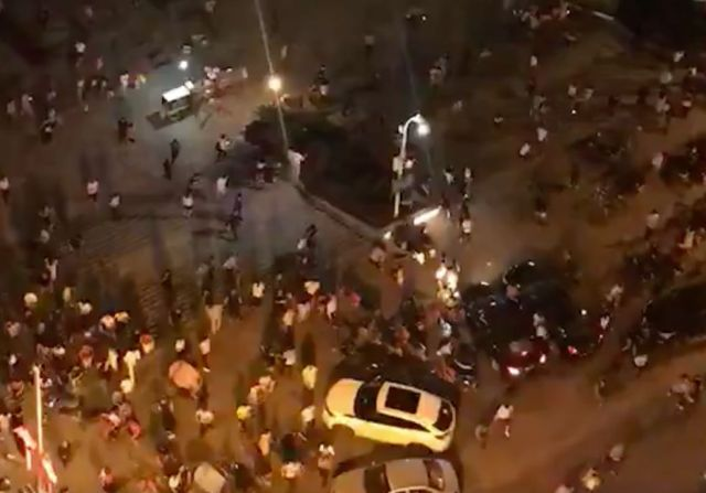 Screengrab shows people fleeing a pedestrian area in the Chinese city of Hengyang in Hunan province after a driver plowed a v