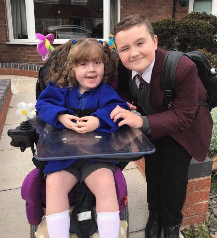 Nick Ollerenshaw, 12, helps look after his sister, Willow. He is one of thousands of children who look after a family member at home.