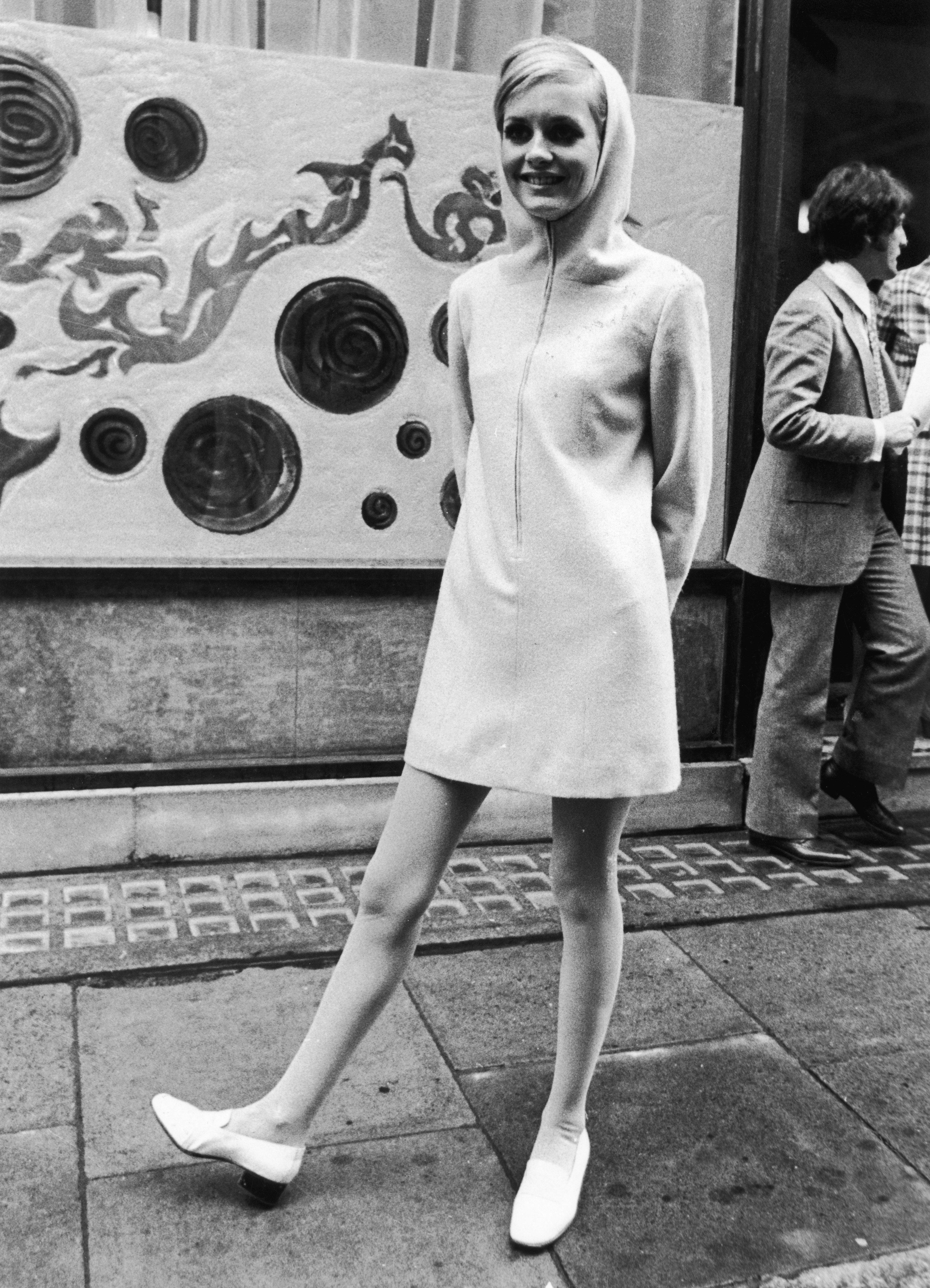 Twiggy, then 17, wears a hooded minidress in London.