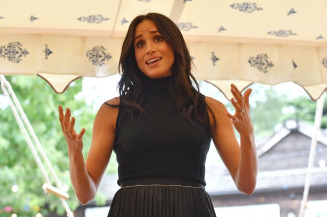 Meghan speaking to the guests at the cookbook event.