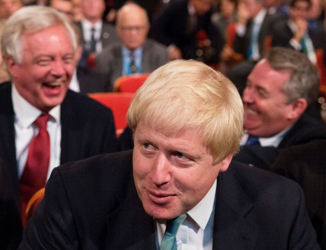 David Davis, Boris Johnson and Liam Fox have a laugh in the audience at the Conservative party conference at the International Convention Centre, ICC, Birmingham