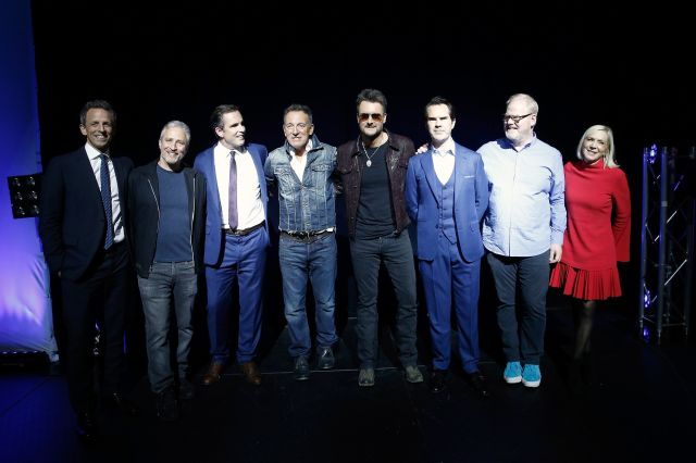 (From left) Seth Meyers, Stewart, Bob Woodruff, Bruce Springsteen, Eric Church, Jimmy Carr, Jim Gaffigan and Lee Woodruff at