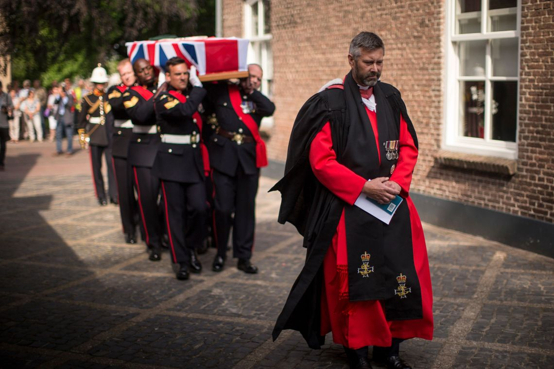 The coffin of David Williams, being carried by members of the Royal Marines
