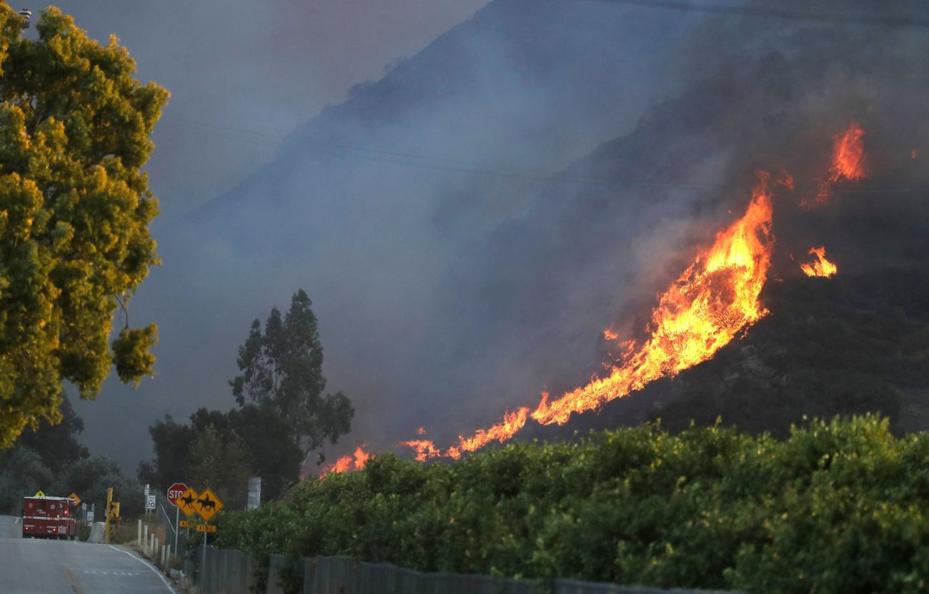 A wildfire comes down from a hilltop near Newbury Park, Calif., onNov. 8.
