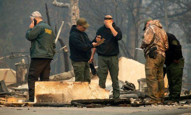 Sheriff's deputies recover the remains of Camp Fire victims on Saturday, Nov. 10, 2018, in Paradise, Calif.